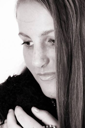 Close up of female teenager against a white background