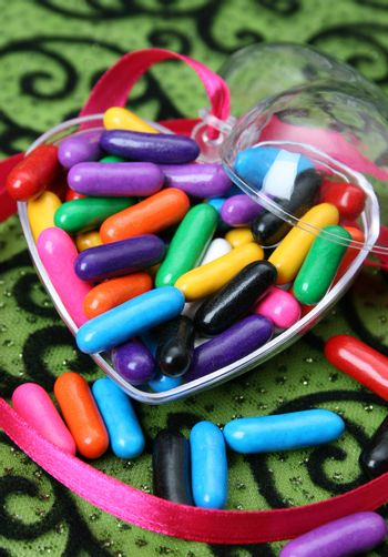 Lost of colorful sweets in a heart shaped container