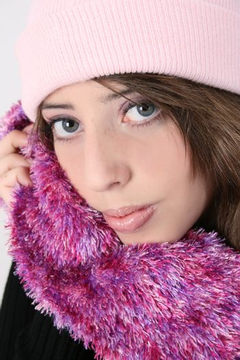 Beautiful teen female wearing a warm pink scarf