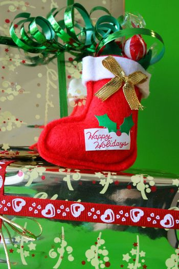 Miniature Christmas Stocking on a gold wrapped gift