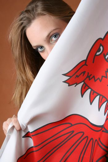 Beautiful young female model with a Welsh Flag