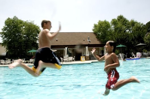 Friends playing at the pool