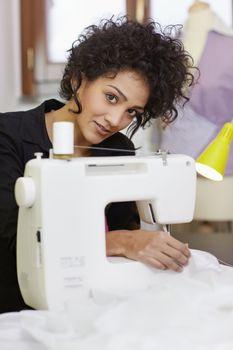 Fashion designer with sewing machine