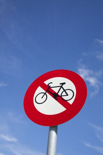 No bicycle sign with blue sky background