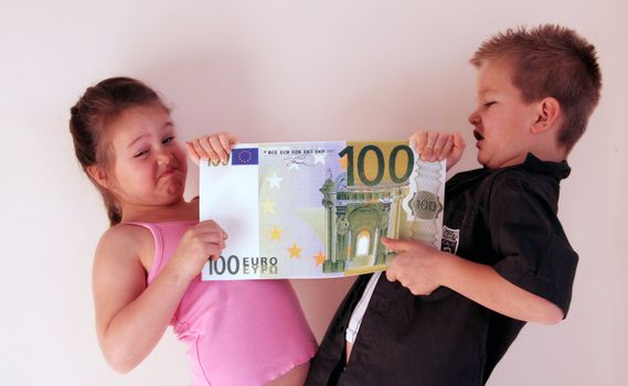 Little Child holding 100 Euro in the hands