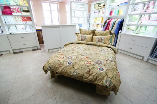 Modern and beautiful bed in shop of bed-clothes