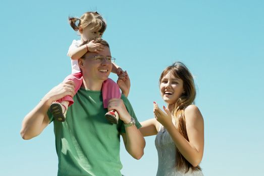 Happy family against the sky