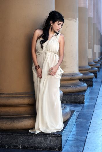 The fine young girl with a light dress. Romance style