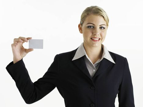 young business woman holding card looking at camera