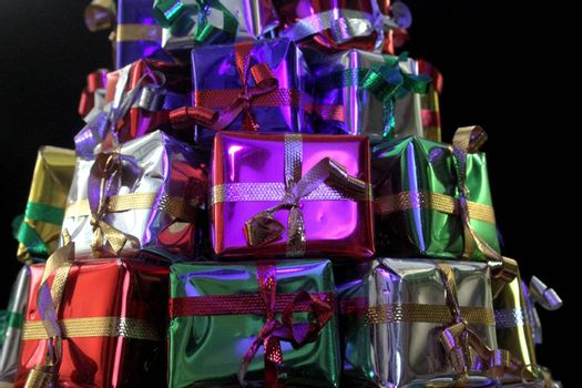 Stack of wrapped gifts in foil