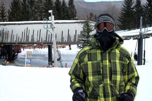 Skier hidden behind goggles and ski hood