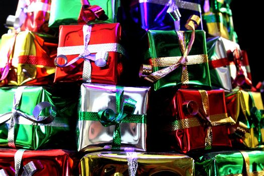 close up of wrapped gifts stacked as a pyramid
