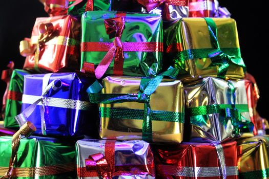 Stack of gifts wrapped in foil