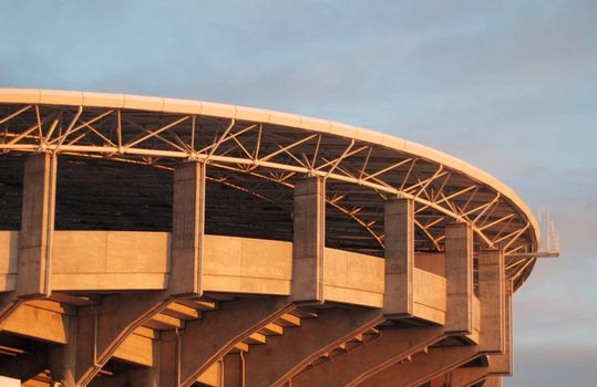 Outside of Upper tier of concrete sports stadium in evening light