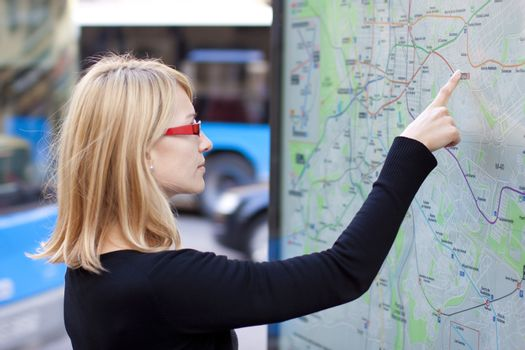 Woman orientating herself on the public transport map.