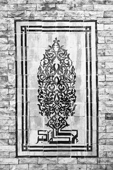 Mosaic on the brick wall