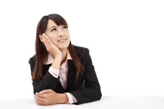 Asian Business woman looks upward and thinks