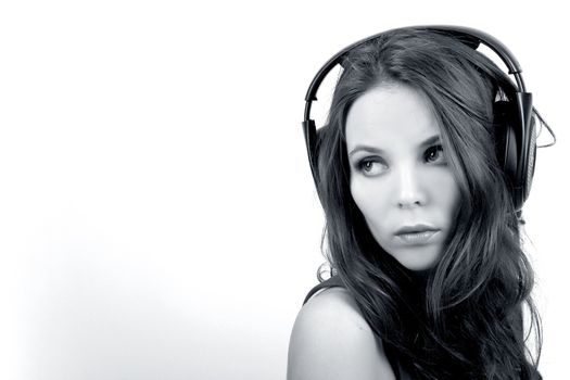 Young dj girl on white background