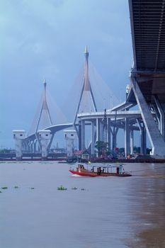 Bridge and tug-boat in Bangkok, Thailand