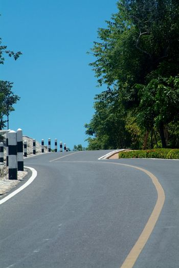 Winding road over a hill