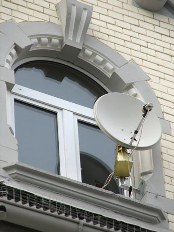 modern communication device on an old building