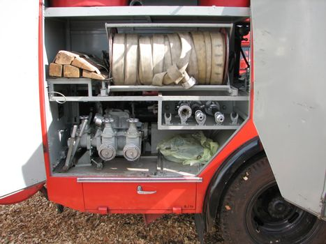 equipment inside a fire brigade car, seen on a street, open to the public for show
