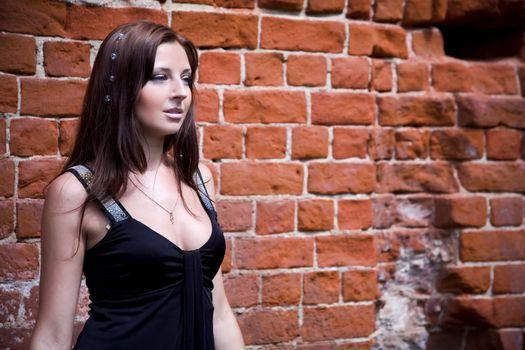 Woman near brick wall