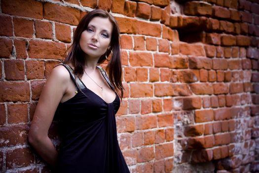 Charming woman near brick wall
