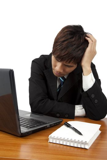 Young  business man having stress or a headache