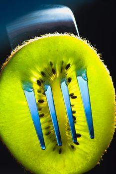 Slice of kiwi on a fork