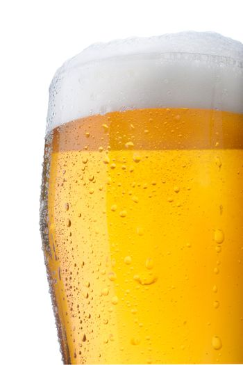 Fresh glass of pils beer with froth and condensed water pearls isolated on white background