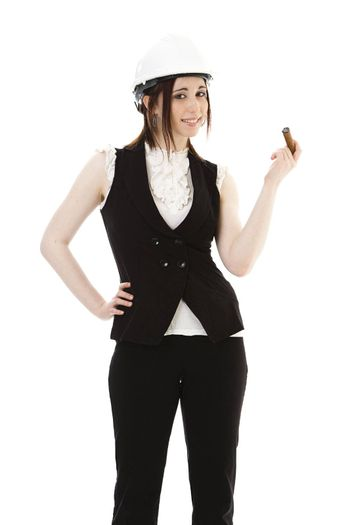 Young business woman wearing a business suit and construction smoking a cigar against a white background