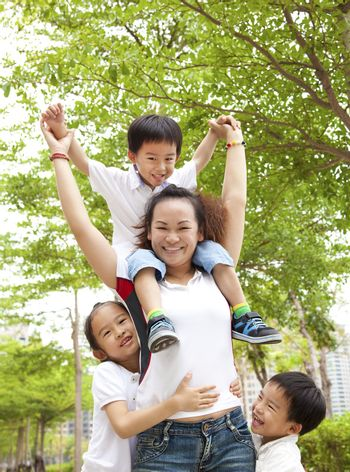 Happy Asian Mother with her daughter and son