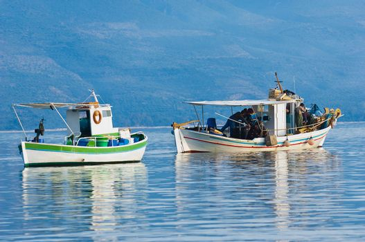 Two fishing boats in a southern Greece bay