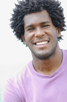 young african man smiling at camera