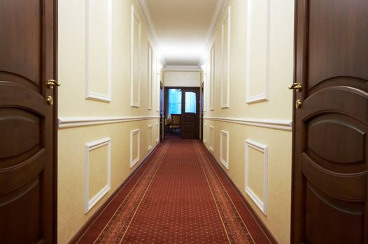 Long corridor with a window in modern hotel