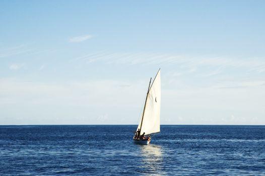 Sailing boat in open sea
