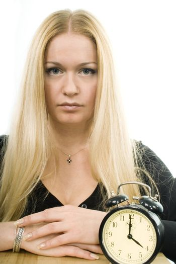 blond woman with clock