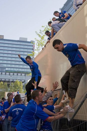 Rangers Fans jumping off a truck in piccadilly gardens