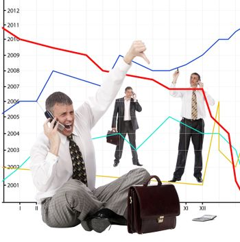The businessman angry falling of exchange indexes phones in company office