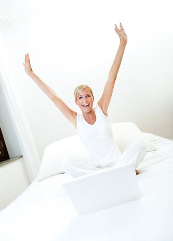Woman working on bed