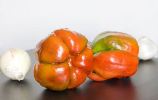 Still life of peppers and garlic