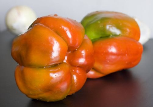 Still life of two peppers