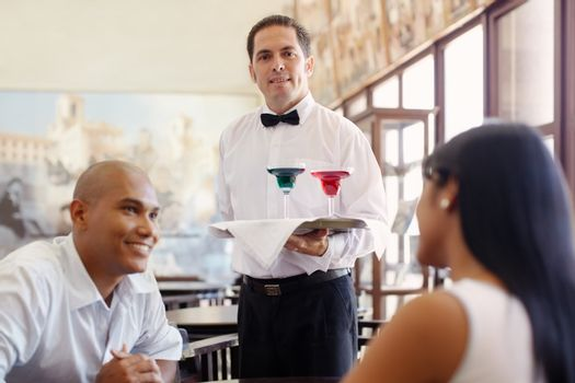 waiter standing with tray in restaurant