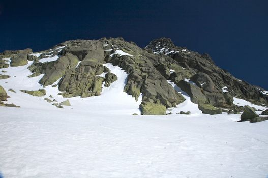 rock peak on snow