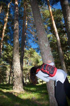 woman hidden at a tree