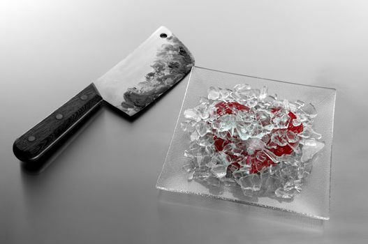 Broken heart with bloody knife