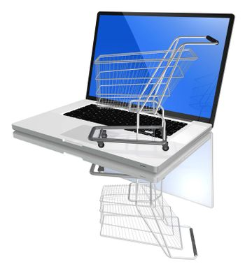 Shopping-cart over a white laptop isolated on white background with reflection