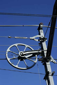 Electric railway steel infrastructure over blue sky