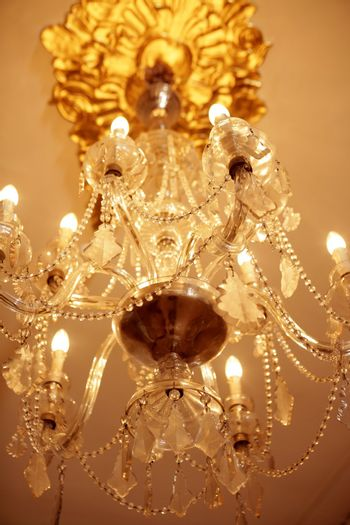 Old electric chandelier lamp